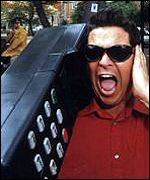 Dom Joly from Trigger Happy TV with his massive mobile